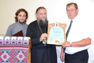 Bishop Iov has awarded President of Orthodox V parishes Yakim Lopushinsky with a certificate of merit. Fr Alex Suraev