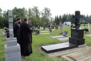 A brief funeral prayer at the burial of Archbishop Panteleimon at the cemetery of the parish at Nisku